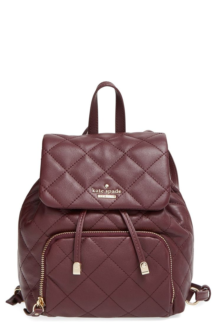 Loving this quilted wine colored backpack by Kate Spade with gold hardware. It allows for organized, studious style while being totally chic.