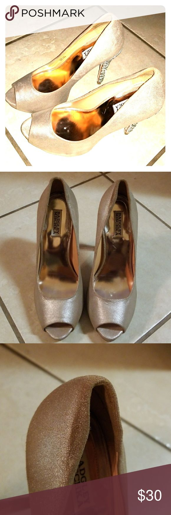 Badgley Mischka Gold Shimmer Silver Heels Badgley Mischka Gold Shimmer Silver Embellished Diamond Peep Toe Heels. I bought them at Nordstoms Last Chance store  for $49.99. Beautiful used shoes that I cannot wear due to a recent back injury. My loss is your gain. Leather shoes, soft and ultra comfortable. Soles have cushion.  They are used shoes. Asking $30 obo. Shoes sold new for $199.00 Badgley Mischka Shoes Heels