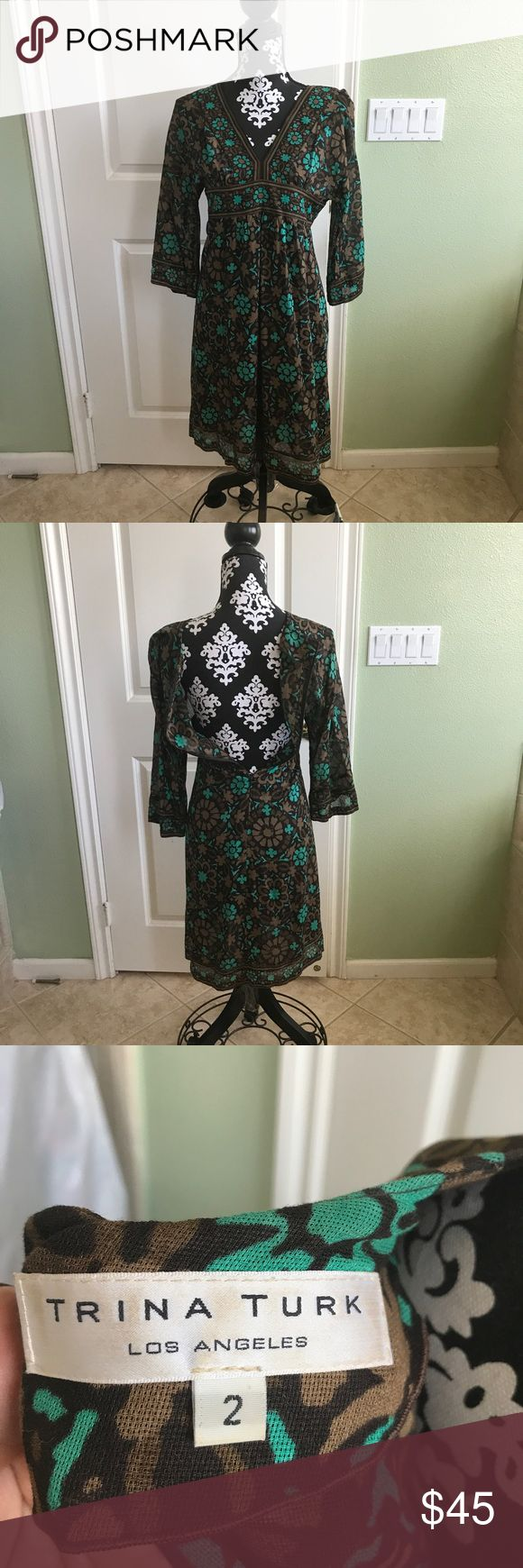 Trina Turk Long sleeve Floral dress In great pre loved condition no rips stains or tears great for work or a night out. Has a zippered back Trina Turk Dresses Midi