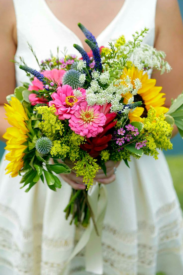 Beautiful Hand Tied Wedding Bouquet Arranged With: Blue Globe Thistles, Blue-Violet Veronica, Yellow Sunflowers, Yellow Solidago, White Queen Anne's Lace, Pink Zinnias, Red Curcuma, Greenery & Foliage