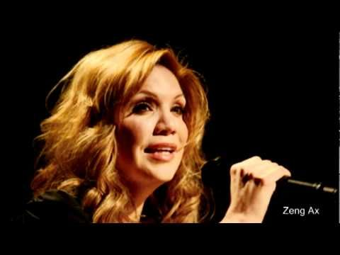 Allison Krauss singing I Will. Amazing Song.  I can listen to this over and over.