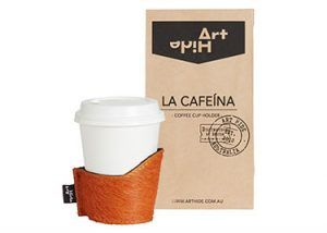 LA CAFEINA - ORANGE Coffee lovers everywhere will love Art Hide's new Cafeína cowhide coffee cup holders. Designed for take away coffee, the Cafeína not only looks super stylish, but also keeps coffee warmer for longer and ensures you don't burn your hands! The Cafeína is available in a range of gorgeous Art Hide signature leathers and comes packaged in a rustic coffee bean style paper bag