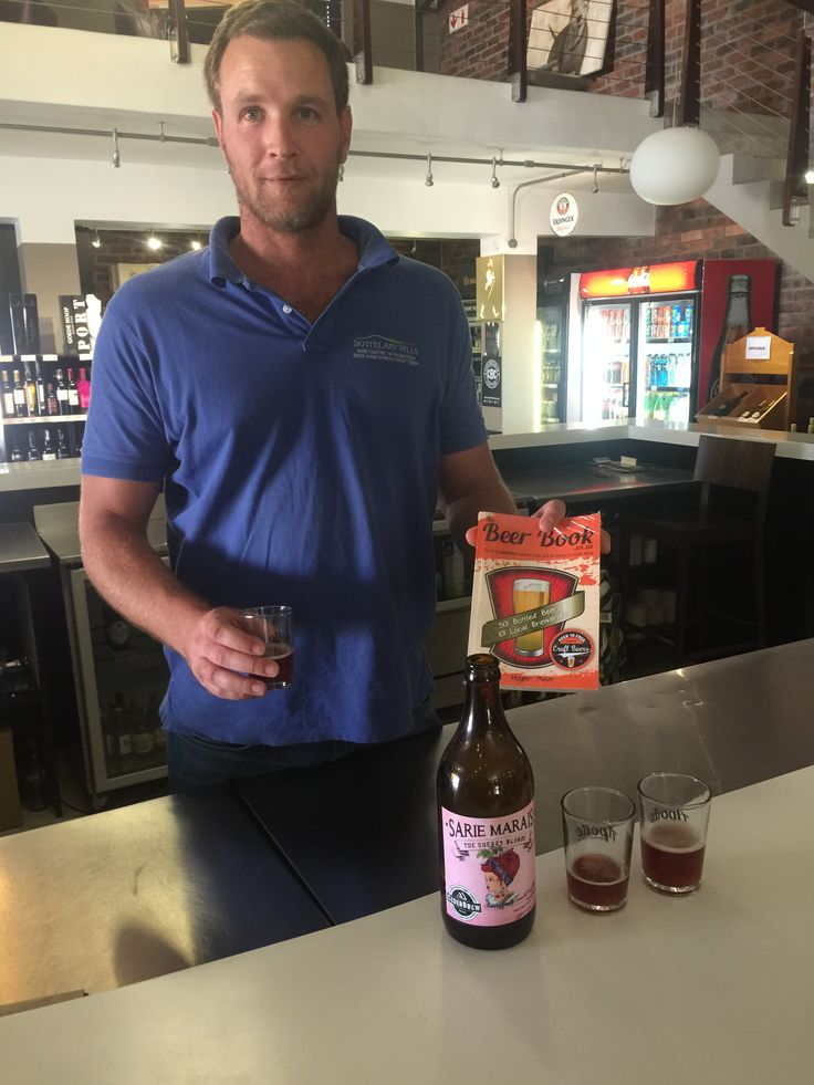 Bottelary Hills wine Centre not only sells wine, they have a great selection of craft and imported beers.  Holger and Frans taste  Cederbrew's Sarie Marais The Cherry Blonde.