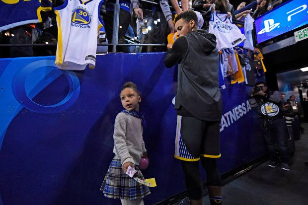 Riley Curry stands with her father Golden State Warriors' Stephen Curry (30) as he signs autographs before the start of their NBA game at the Oracle Arena in Oakland, Calif., on Saturday, Dec. 30, 2017. Curry returns to the floor tonight after sustaining an ankle injury on Dec. 4th. (Jose Carlos Fajardo/Bay Area News Group)