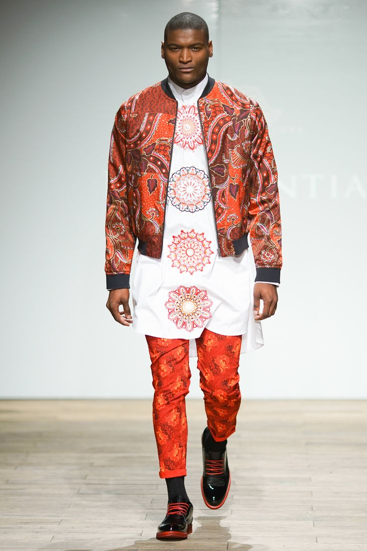 Hand-painted silk bomber jacket worn with African inspired printed pants and a long circle printed mandarin tunic. #SAFW #SAFWmen #SAFAW17 #PresidentialSAFW #AfricanHauteCouture #HeritageMonth #MadInSA