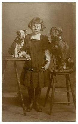 Vintage photo of a young girl posing with her two best friends