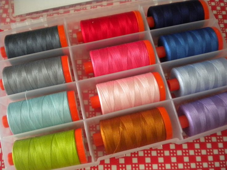 All About Threads: Threads for Piecing and Quilting  Different Colored Threads in A Thread Organizer Box