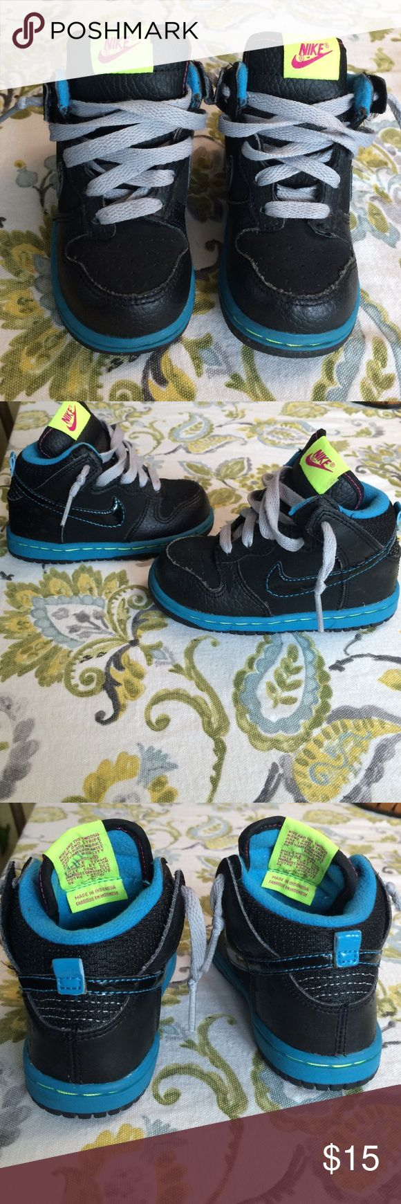 Nike high tops for children size 7C Adorable in black leather with bright blue lining and piping. From 2012 Nike line. Gray laces. Almost no wear. Soles in excellent condition. Smoke free home. Nike Shoes Sneakers
