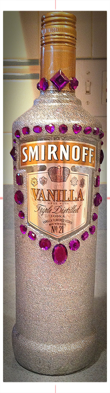Decorated alcohol bottle, glitter spray paint, purple rhinestones, pretty, fun, center piece, Smirnoff vanilla