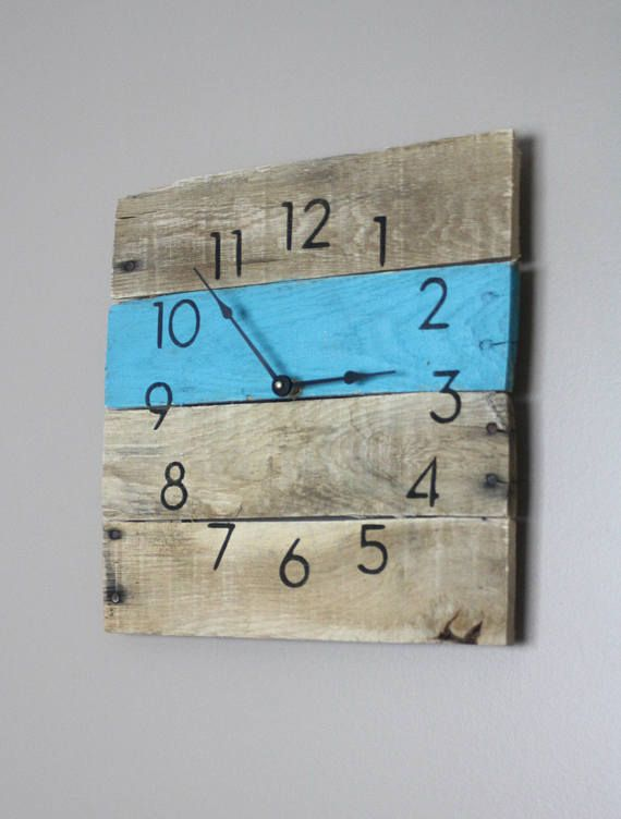Welcome to the one and only terrafirma79 designs. Thank you for considering our artisan pallet wood clock shop for your home decor or gift giving needs. Here is a modern yet rustic wall clock with a dash of vibrance in turquoise. This modern yet rustic clock is perfect for any home or