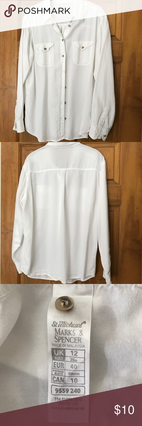 Crisp white, long sleeve, button down blouse. Divine button down for jeans with a blazer or on it's own. Size UK 12. Marks & Spencer Tops Button Down Shirts