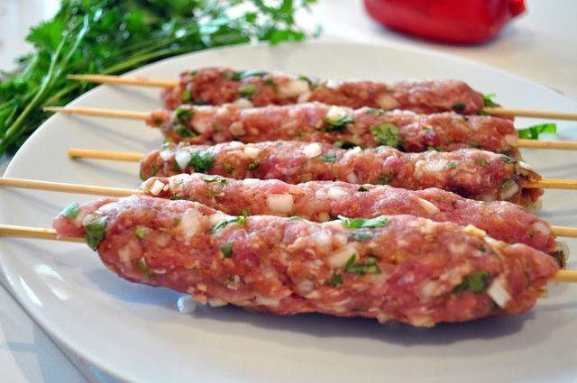 Kefta is ground beef or lamb, typically mixed with cumin, paprika, minced onion, coriander and parsley. Cinnamon, hot ground pepper, and mint leaves are optional. The recipe below shows traditional quantities of these spices and herbs.