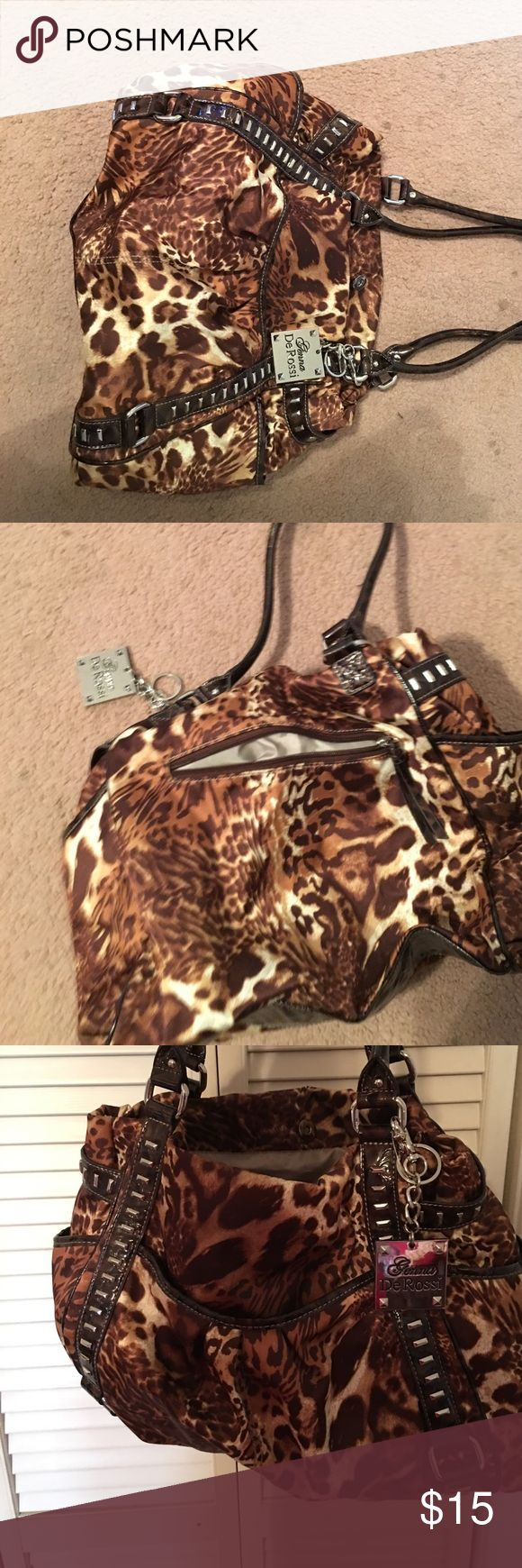 Genna De Rossi leopard purse Leopard purse with multiple pockets. No rips, tears or stains. Bags Shoulder Bags