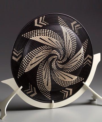 This not woven, but check out this site for some beautiful basket illusions in wood!