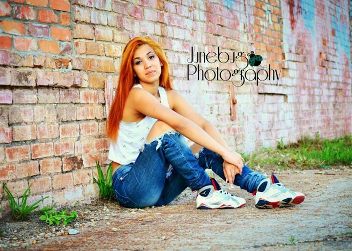 Senior pictures girl, downtown, brick wall, urban