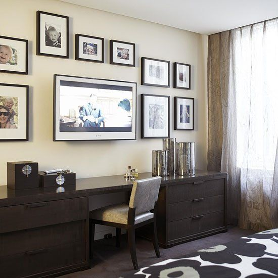 On this wall, the flatscreen blends in with other framed art. You can do something similar in your home by surrounding the flatscreen with framed photos and artwork. Source