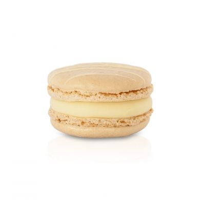 White Chocolate Macaron. A smooth white chocolate ganache filling with white chocolate drizzled shells