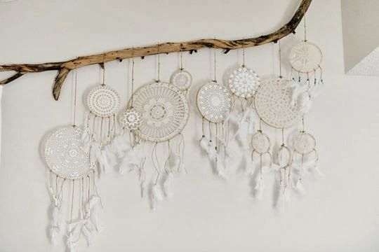 doily dreamcatchers | hang dreamcatchers on a branch as wall art. LOVE THIS.