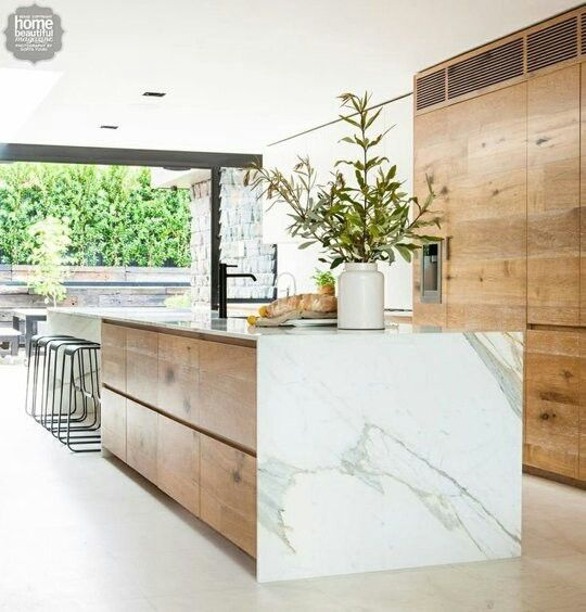 A marble countertop returning to the floor (in this case at the end of an island). It's a sleek look that nicely balances out the rustic wood cabinetry.
