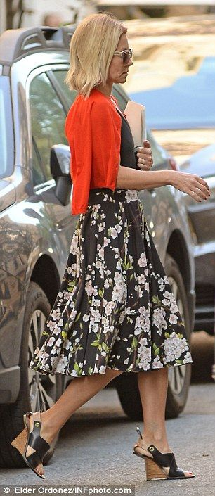 I love the dress & shoes!  Moving on: Kelly Ripa's rose tattoo was barely visible as she stepped out in Thursday in New York City.