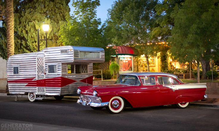 Vintage red and silver camper and matching car