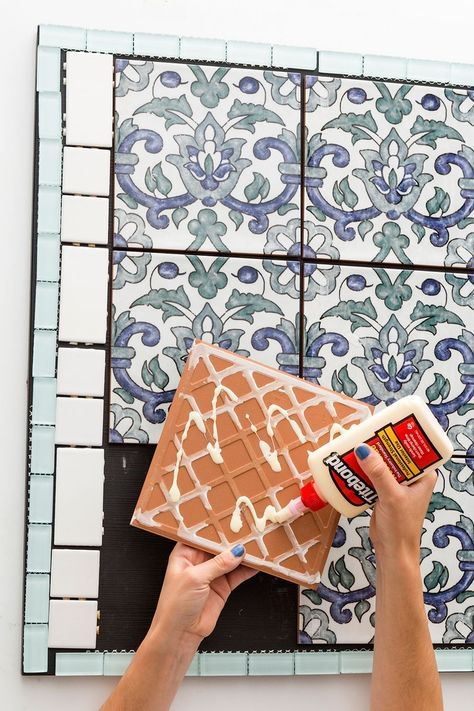 Follow this home decor DIY IKEA hack to make a mixed tiles and glitter grout table.