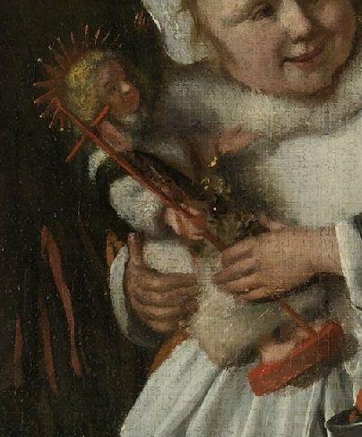 Verbod genegeerd ... In 1657 kondigde de stad Dordrecht zelfs een verbod af voor het hele St. Nicolaasfeest. De Hervormde kerk noemde de viering een 'restant der paperijen', 'strekkende tot waengelooff...ende afgoderije'. Deze maatregelen hadden echter weinig effect. Jan Steen was zelf katholiek en liet zich niet weerhouden dit vrolijke familiefeest af te beelden. Het kado van het meisje laat zien dat het afgebeelde gezin ook daadwerkelijk katholiek was: het is een Sint Janspopje.