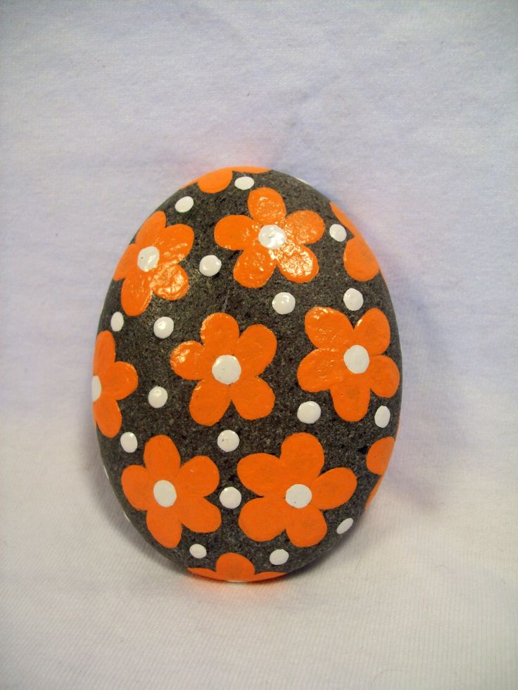 hand painted beach stone by Jessica Newton