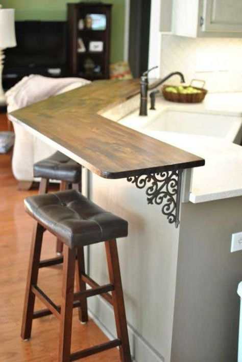 8. Add a breakfast bar to your kitchen and support it with iron brackets.