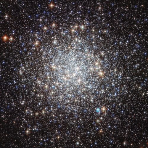 Rainbow Star Cluster Sparkles in Stunning Hubble Photo  The globular cluster Messier 9 shines in this new photo from the Hubble Space Telescope. Credit: NASA & ESA  Hundreds of thousands of glittering stars shine in a cluster at the center of our galaxy in a new photograph from the Hubble Space Telescope.
