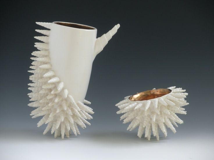 Ceramic vessel with cup.  Wheel thrown vessel, hand-built spirals; individually attached.  Glaze with gold luster firing.    Katherine Dube 2000-2013.