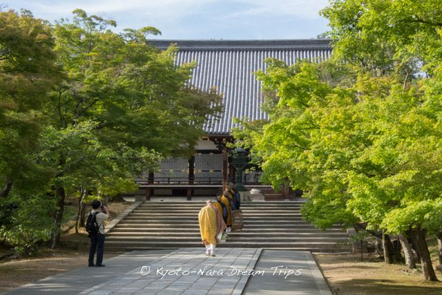 View of the Kondo (金堂) in Ninna-ji temple. It Is the main hall of the Ninna-ji temple. These monks are returning to the Kondo for their evening prayers.