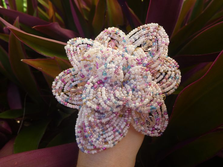 A large beaded flower design created with wire, glass seed beads, crystal beads and swarovski crystal pearls. Good for creating large bouquets, or for use in a smaller bridesmaids bouquet. Picture this surrounded by sprays of pearls and crystals.