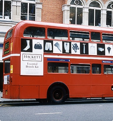 """1988 - Hackett starts to advertise in a small way and adopts two devices, which prove to have longevity, the chequer board advertising style and the strapline, """"Essential British Kit"""", the perfect summation of everything that Hackett is about."""