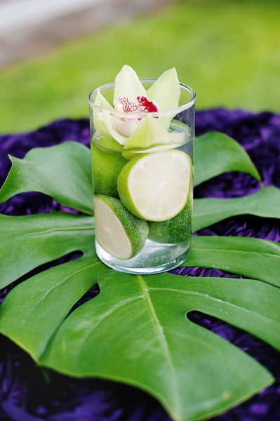 Simple centerpiece for a tropical wedding, perhaps replace limes with something else, or have flowers inside with a floating candle on top.