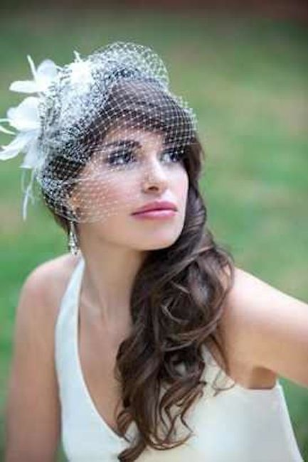 Wedding Hairstyles for Long Hair – A simple wedding hairstyle for long hair that incorporates a charming little netted veil with a flower.