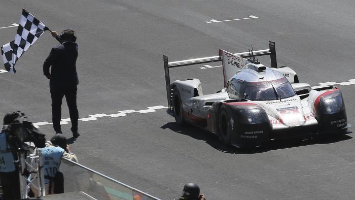 Greatest come back! The No. 2 Porsche crosses the line victorious after 367 laps. 24hr of Le Mans 2017