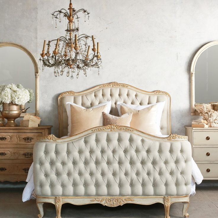 Nice Brushed Bronze Antique Chandelier Over Queen Tufted Bed With Curved Vanity Mirror In Traditional Master Bedroom Ideas
