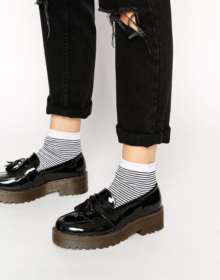 Loafers with striped ankle socks and folded-up jeans
