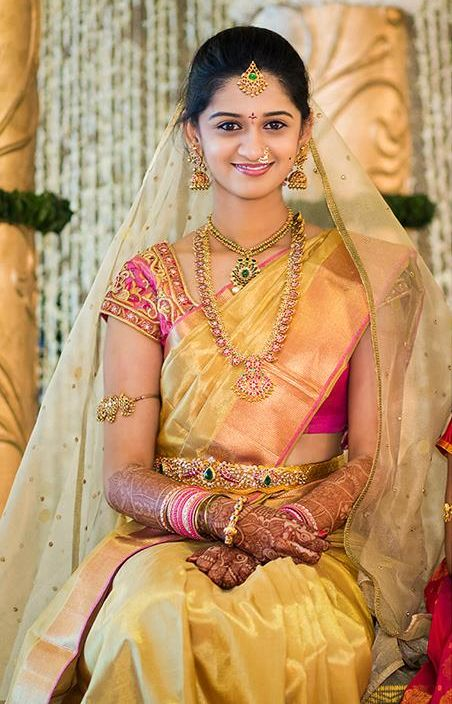 South Indian bride. Temple jewelry. Jhumkis.Yellow silk kanchipuram sari.Braid with fresh jasmine flowers. Tamil bride. Telugu bride. Kannada bride. Hindu bride. Malayalee bride.Kerala bride.South Indian wedding