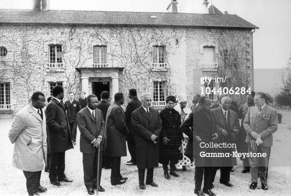 African Heads Of State After The Burial Of De Gaulle In front of the Boisserie at Colombey-les-deux-Eglises. Centrafrican president Jean Bedel BOKASSA (3-L); Mauritanian head of state Makhtar Ulud DADAH (center); Ivorian president HOUPHOUET-BOIGNY (hand in pocket); Malagasy president Philibert TSIRANANA and General DE GAULLE's son-in-law Alain de BOISSIEU. Background: Philippe DE GAULLE and one of his son.: