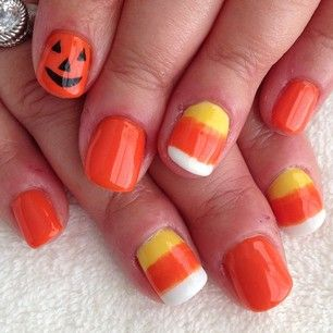 Candy corn accents. | 27 Delightfully Spooky Ideas For Halloween Nail Art