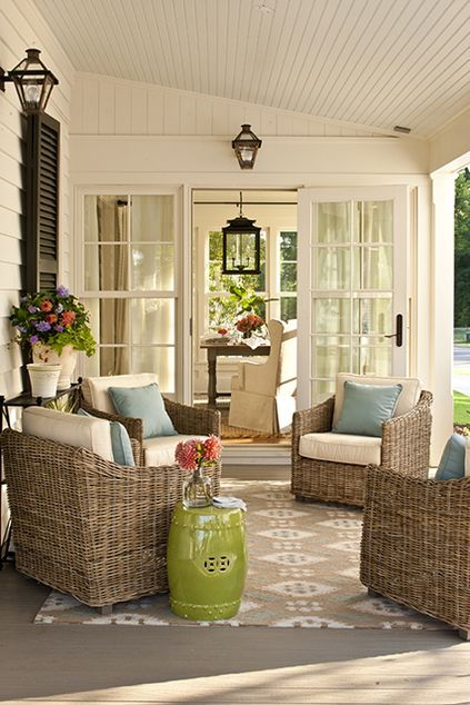 Patio outside of the sun room:    source: Southern Living    Covered porch with black shutters, lime green garden stool, wicker chairs, powder blue velvet pillows and Ballard Designs Suzanne Kasler Ikat Indoor/Outdoor Rug. Love the color scheme...What a great place to curl up with a book and a cup of tea.