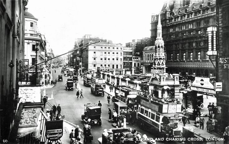 """This is an anonymously published postcard showing the view from Charing Cross looking east along The Strand. The second bus at the bus stop outside Charing Cross Station is carrying an advertisement for """"White Cargo"""" at the Playhouse Theatre, the play ran for three years at four London theatres. At the Playhouse, it ran for a year from May 1924 until it transferred to the Fortune theatre, then the Princes and lastly the Strand. There is a Bow Street police constable on traffic duty at the…"""