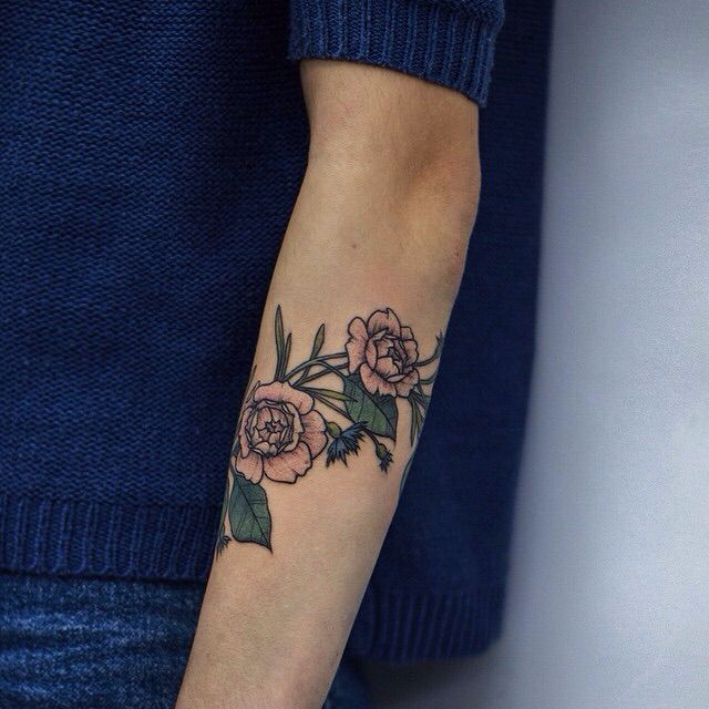 Cute colored rose arm tattoo