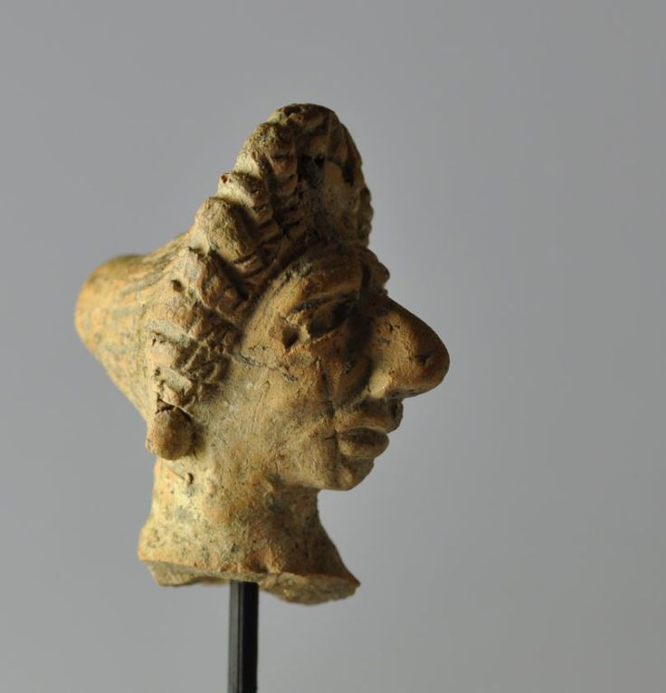 Greek grotesque head, 1st century B.C. Alexandria, Alexandrian grotesque head, Greek grotesque head, Alexandria, Alexandrian grotesque head, terracotta, 5 cm high. Private collection