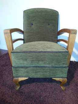 I am buttoned, piped and ready for my new home and life as a stylish seat to last a lifetime