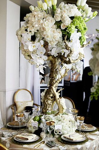 Great Gatsby wedding inspired centerpiecewith white cream roses, tulips,