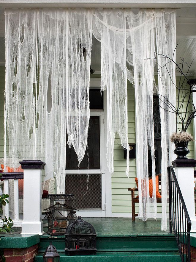 Drape cheesecloth over the front porch to create a spooktacular scene