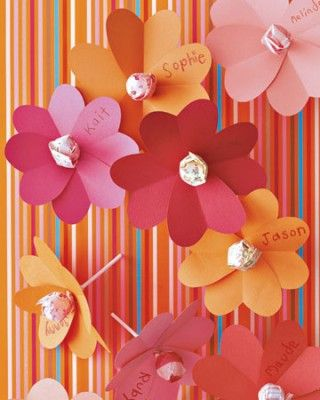 Flowers name tags / also you can put a lollipop in the midle of the flower